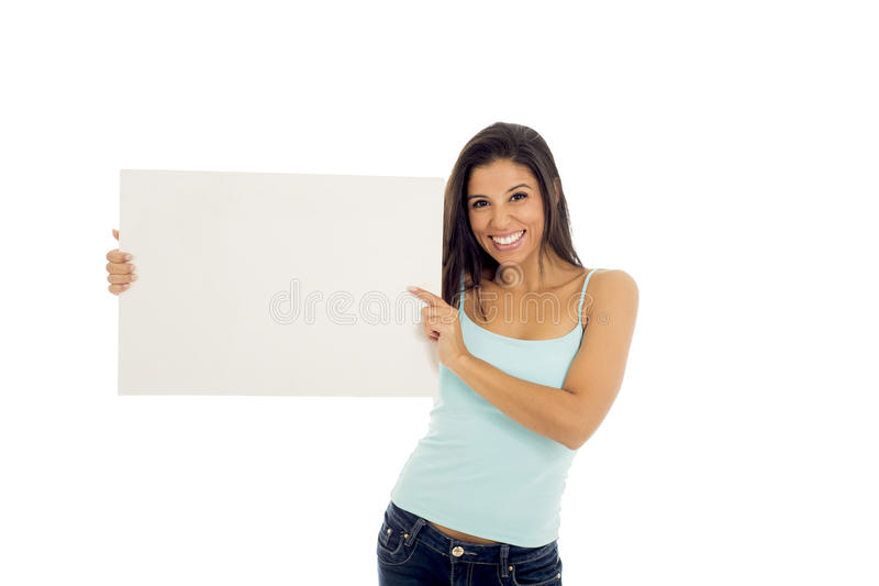 Young attractive and happy hispanic woman holding blank billboard with copy space stock photography