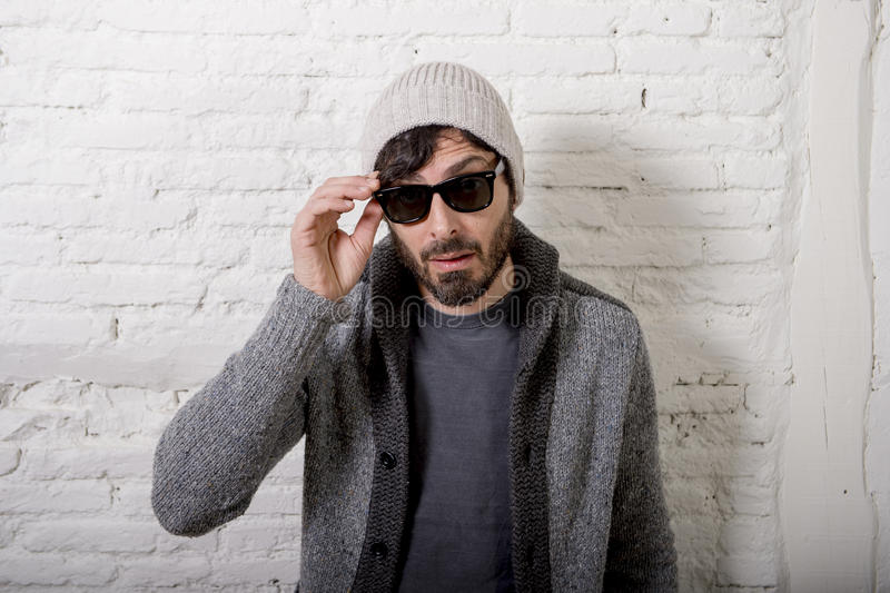 Young attractive hipster and trendy style looking man posing cool with attitude dressing informal royalty free stock photos