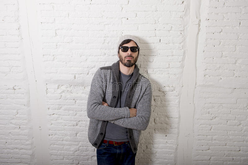 Young attractive hipster and trendy style looking man posing cool with attitude dressing informal stock image