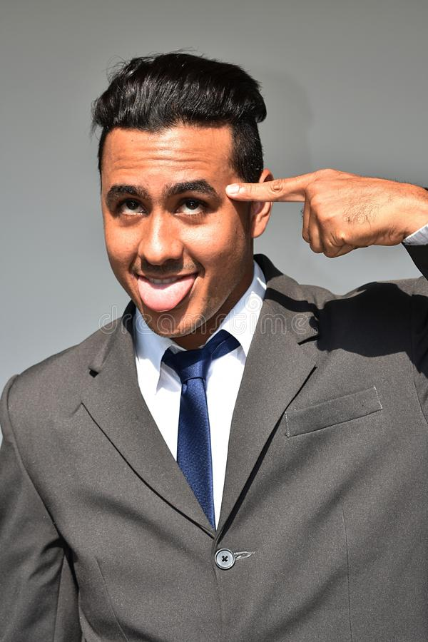 Goofy Business Man. A young attractive hispanic man stock images