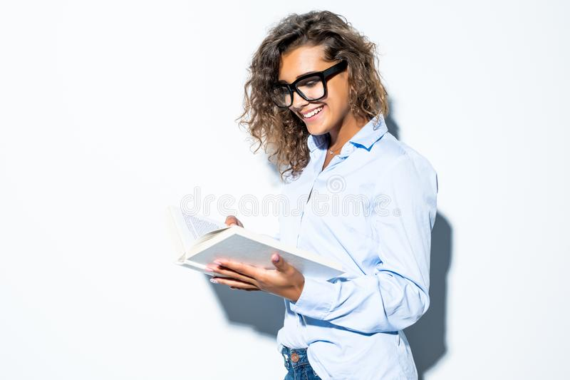 Young attractive latin businesswoman wearing glasses using read book isolated on white background. Young attractive latin businesswoman wearing glasses using stock photos
