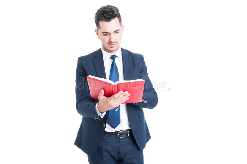 Young attractive lawyer holding and reading a law book stock photo