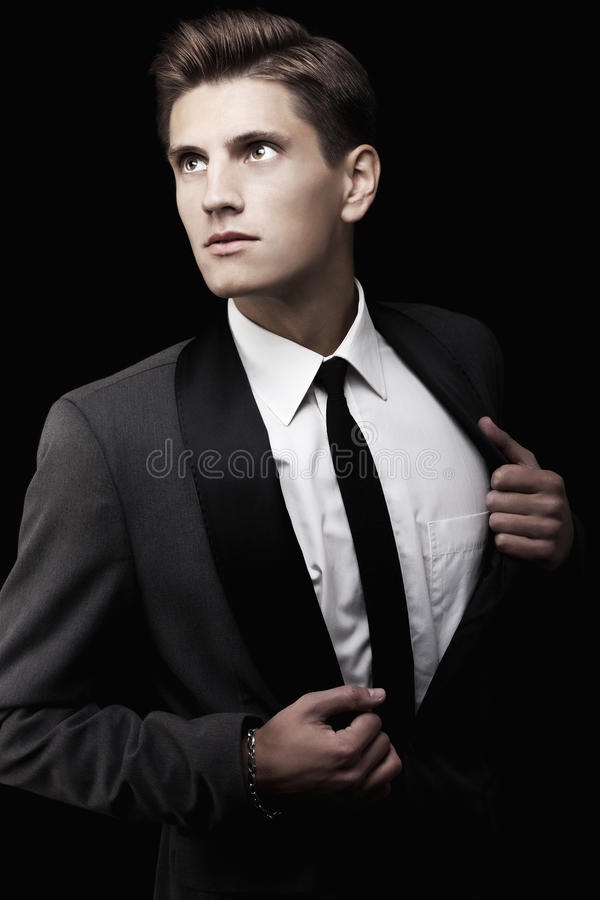 Young attractive macho in suit royalty free stock photo