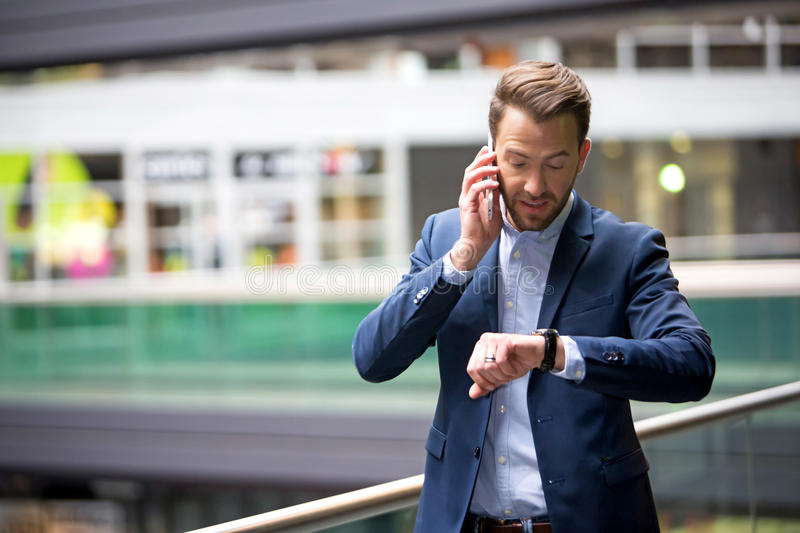 Young attractive man being late to an appointment royalty free stock photos