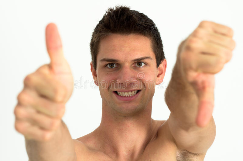 Young attractive man doing thumb up royalty free stock images