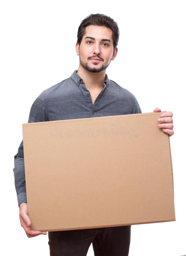 Young attractive man holding an empty board for messages, promotional. royalty free stock images