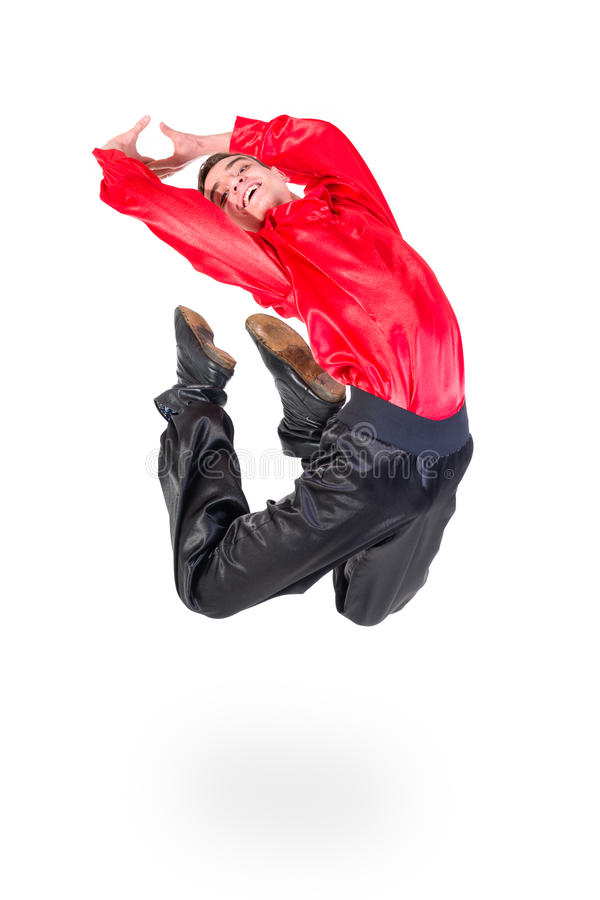 Young attractive man jumping. Against isolated white background stock photos
