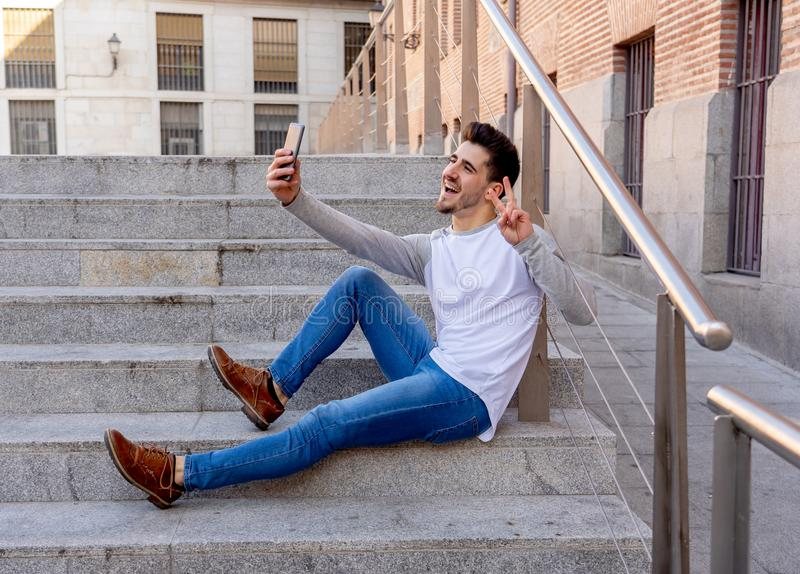 Young attractive man taking selfie while on holidays in European stock photography