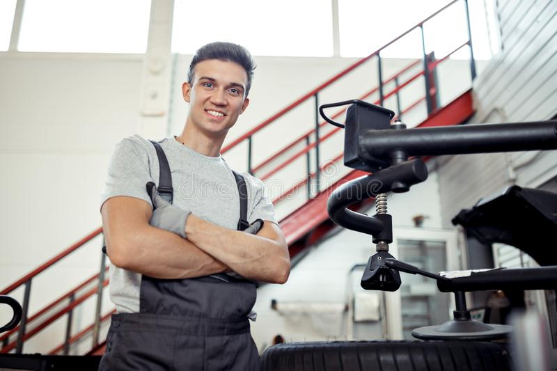 A young attractive mechanic is smiling while having a rest stock image