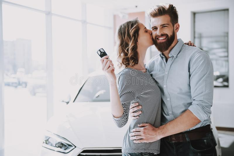 Young Attractive Owners of New Car Hugging royalty free stock images