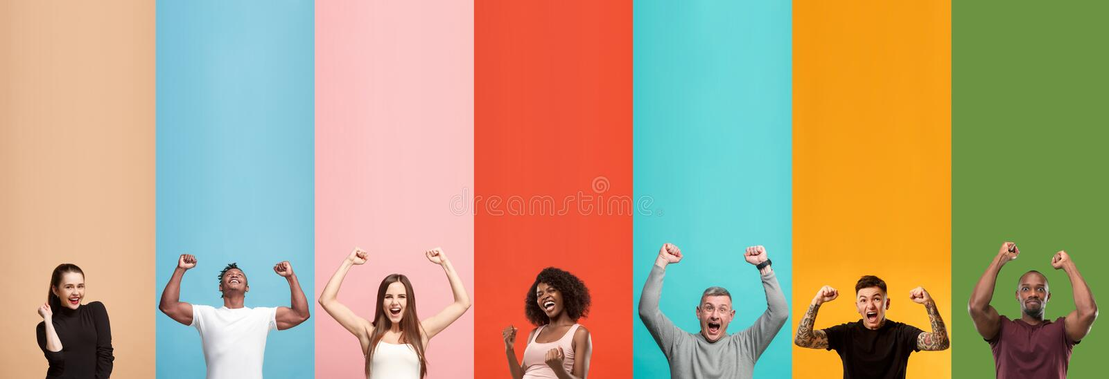 Young attractive people looking astonished on multicolored background stock photography