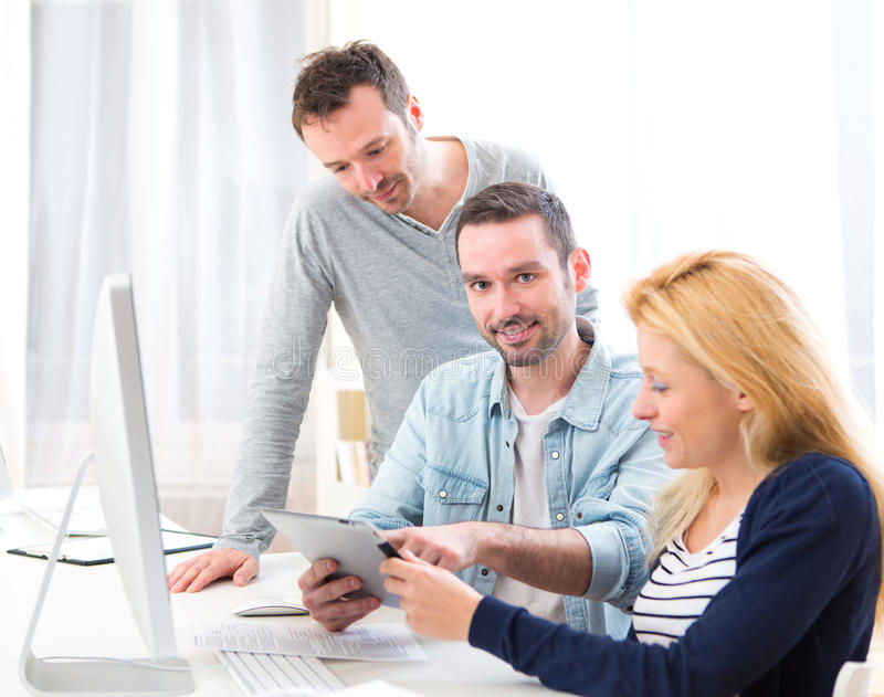 Young attractive people taking a training course. View of a Young attractive people taking a training course stock photo