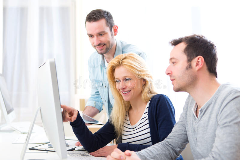 Young attractive people taking a training course stock photography