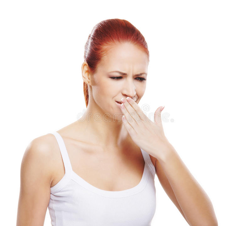 A young and attractive redhead woman coughing royalty free stock photography