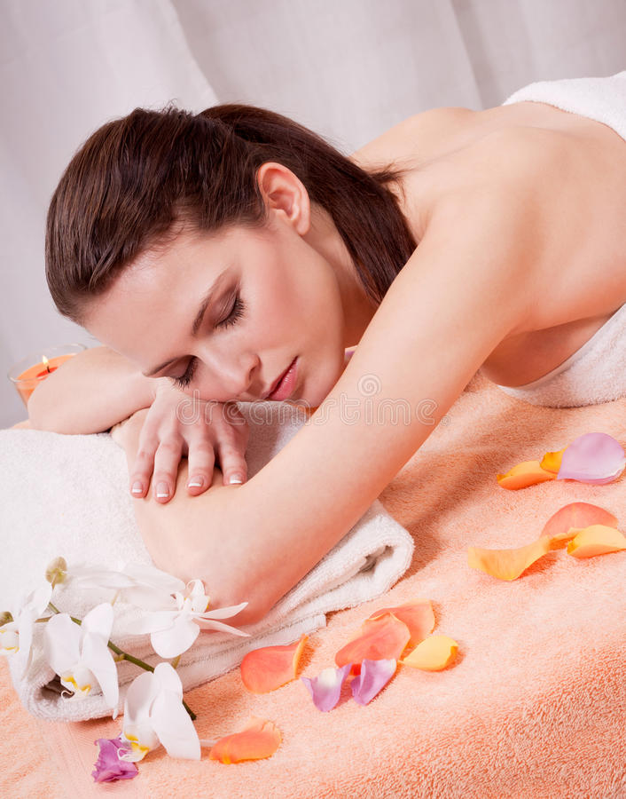 Young attractive smilig woman doing wellness spa. Relaxing massage stock images