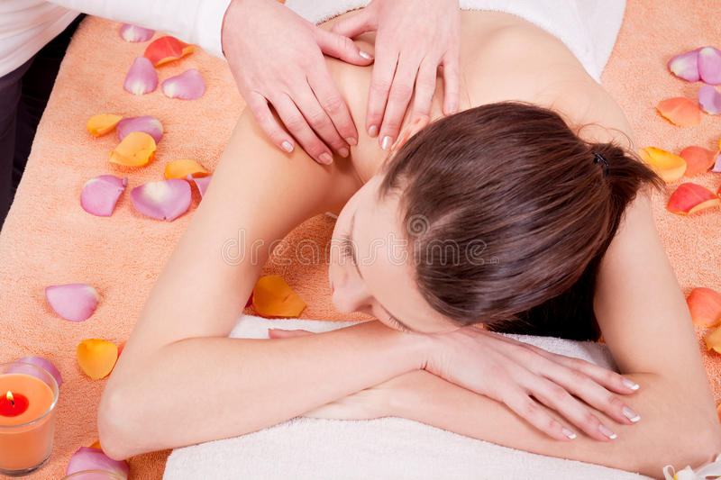 Young attractive smilig woman doing wellness spa. Relaxing massage royalty free stock images