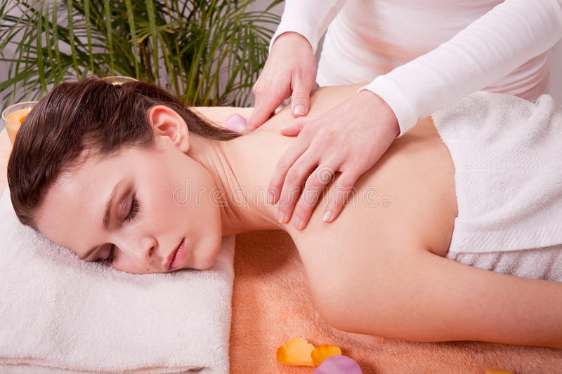 Young attractive smilig woman doing wellness spa. Relaxing massage royalty free stock photography