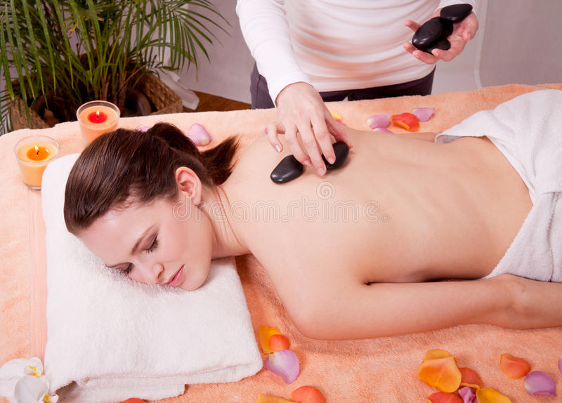 Young attractive smilig woman doing wellness spa. Relaxing massage royalty free stock photo
