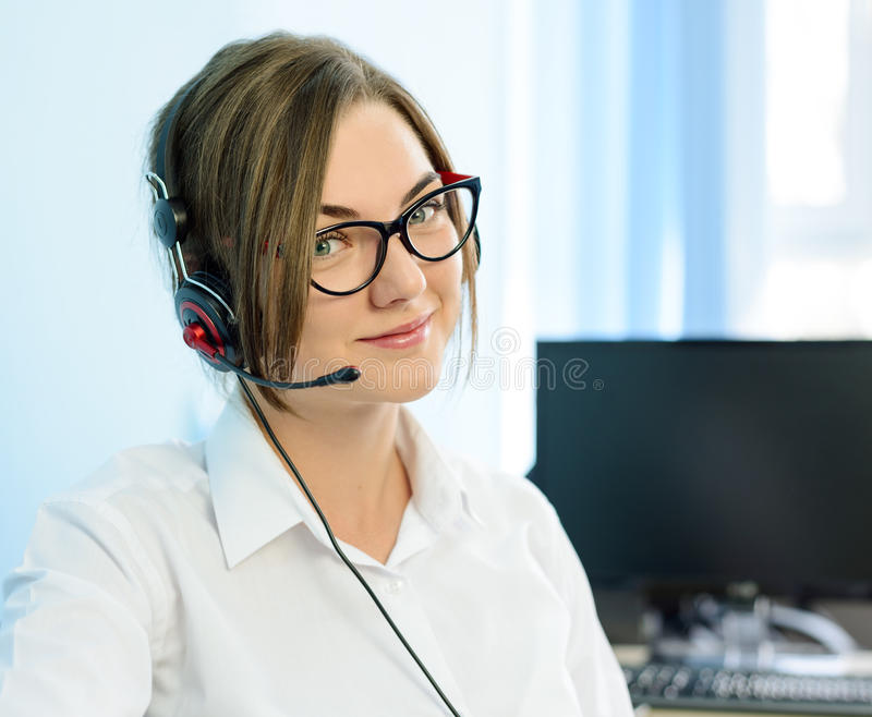 Young Attractive Smiling Customer Support Phone Operator with Headset in Office. stock photos