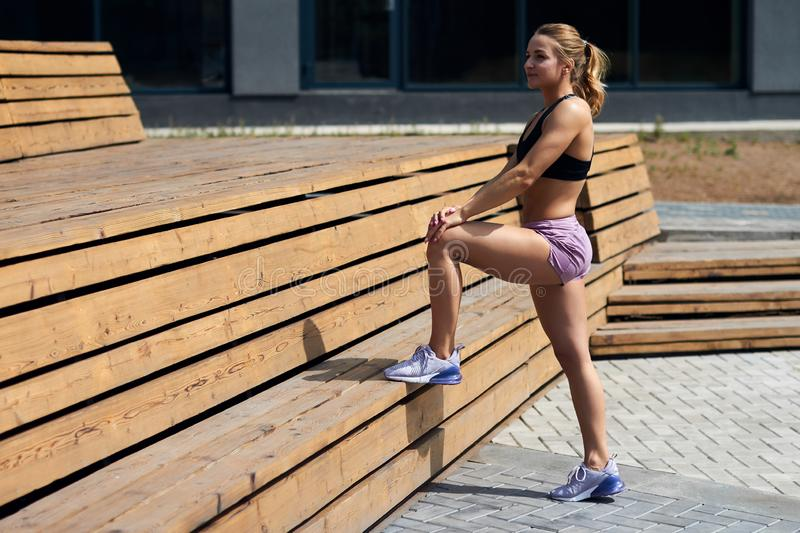 Young attractive smiling happy woman resting after workout royalty free stock photo