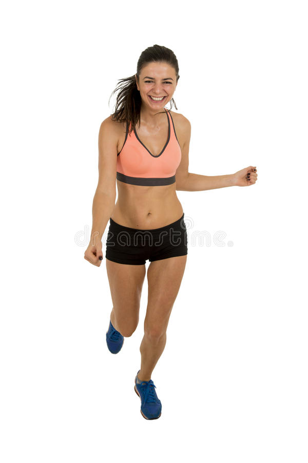 Young attractive sport woman in fitness clothes smiling happy in aerobics training workout. Isolated on white background in sport healthy lifestyle concept royalty free stock photo