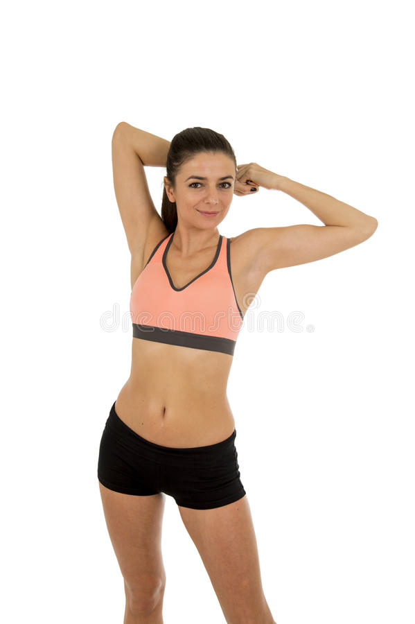 Young attractive sport woman in fitness clothes smiling happy in aerobics training workout. Isolated on white background in sport healthy lifestyle concept stock photos