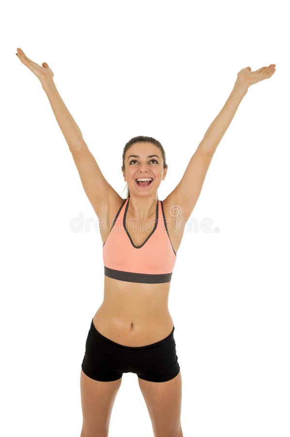 Young attractive sport woman in fitness clothes smiling happy in aerobics training workout. Isolated on white background in sport healthy lifestyle concept stock images