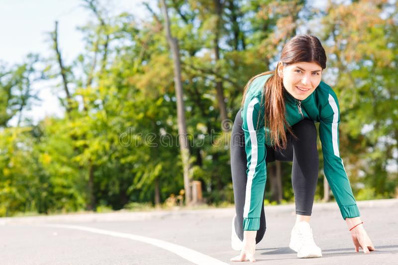 A young, attractive and sporty woman going to be running outdoor. stock images