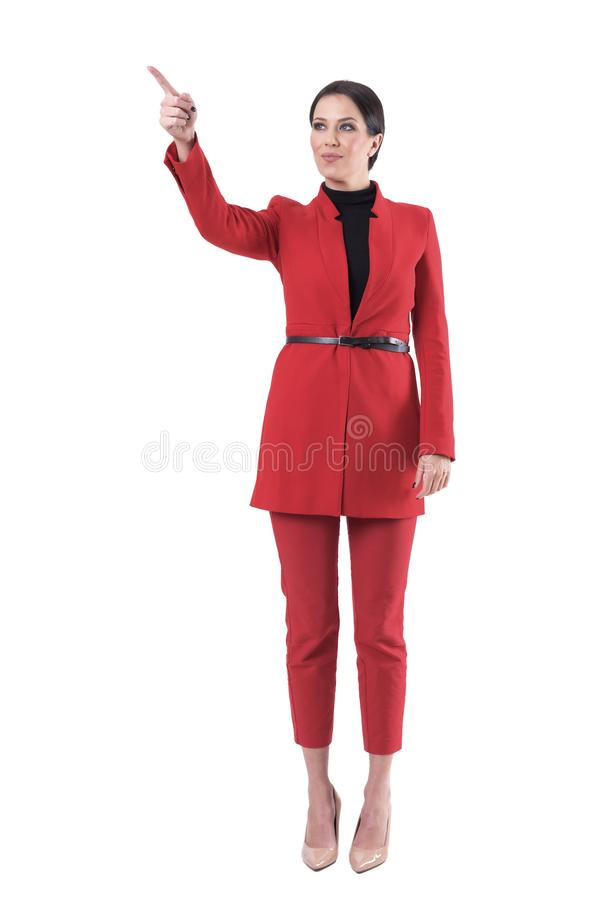 Young attractive successful business woman leader pointing finger showing the way. Full body isolated on white background stock photos