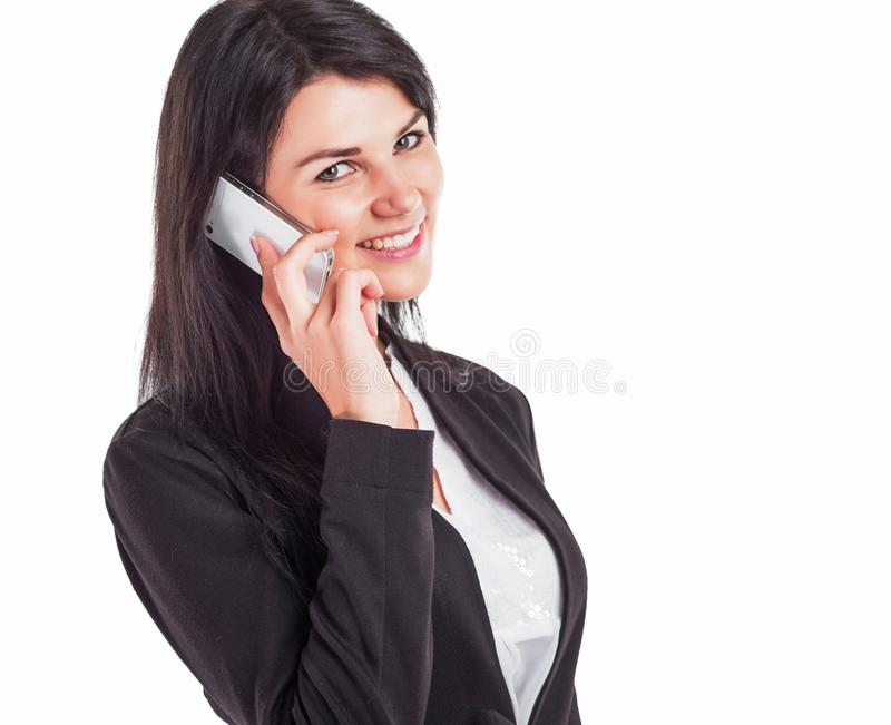Young, attractive, successful business woman, talking on the phone royalty free stock photo