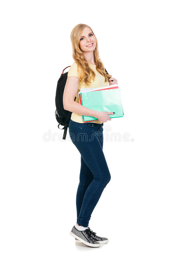 Young and attractive teenage schoolgirl on white stock photo