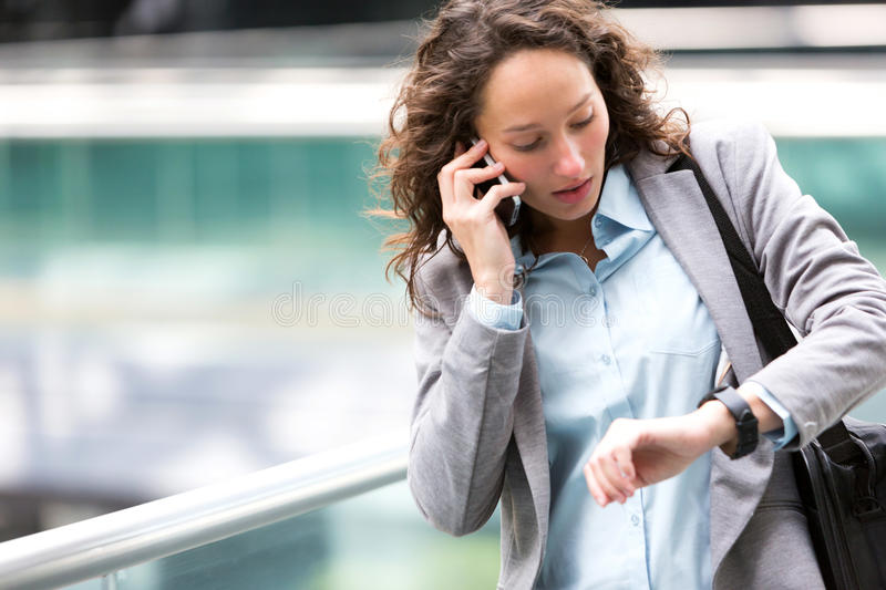 Young attractive woman being late to a rendez-vous stock photography