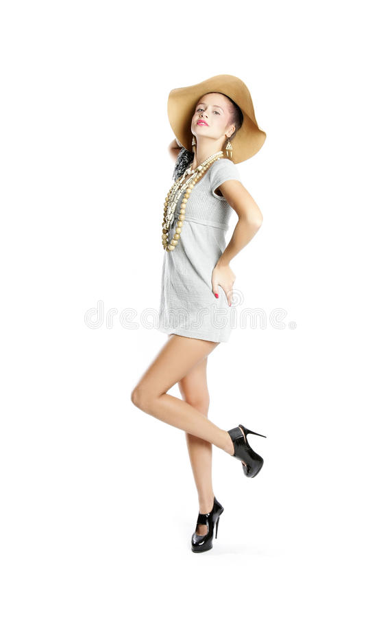 Young attractive woman in big hat stock photo