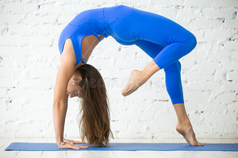 Young attractive woman in Bridge pose, white studio background stock images