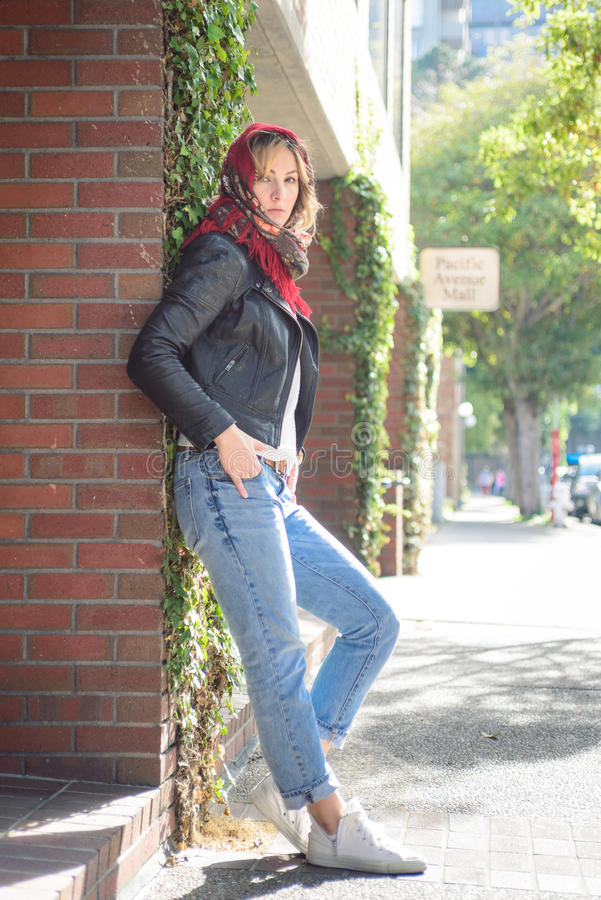 Young attractive woman in the city stock photography