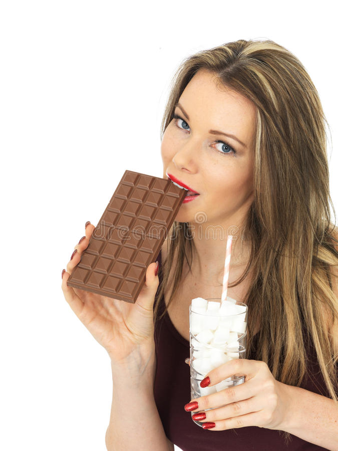 Young Attractive Woman Comparing a Chocolate Bar to a Glass of Sugar stock image
