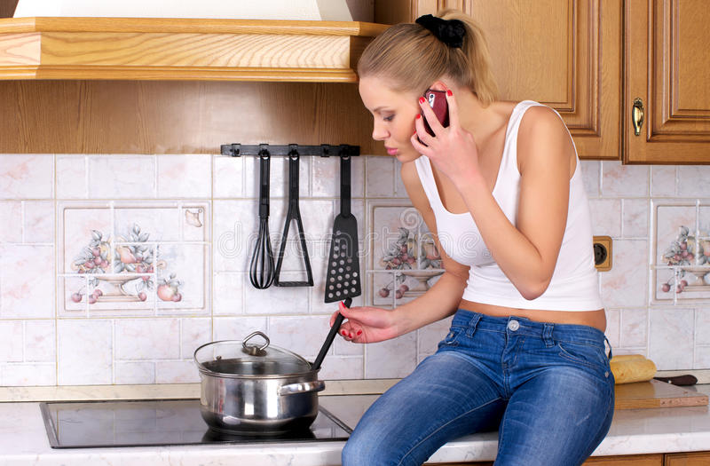 Young attractive woman cooking stock photos