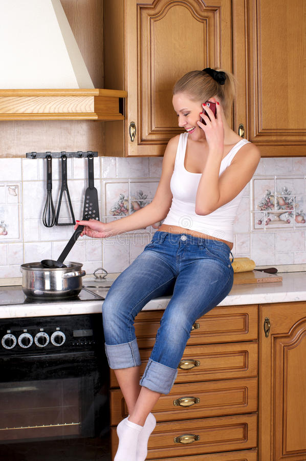 Young attractive woman cooking royalty free stock photo