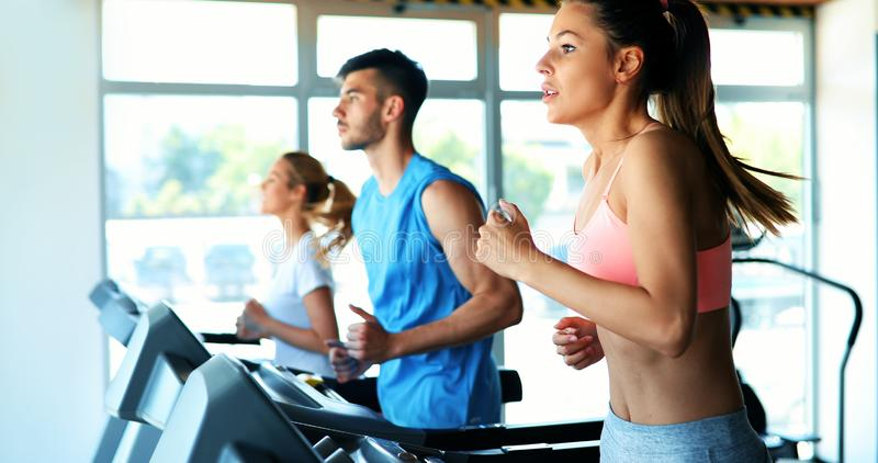 Young attractive woman doing cardio training in gym royalty free stock images