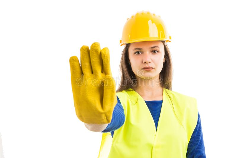 Young woman engineer showing stop sign royalty free stock photo