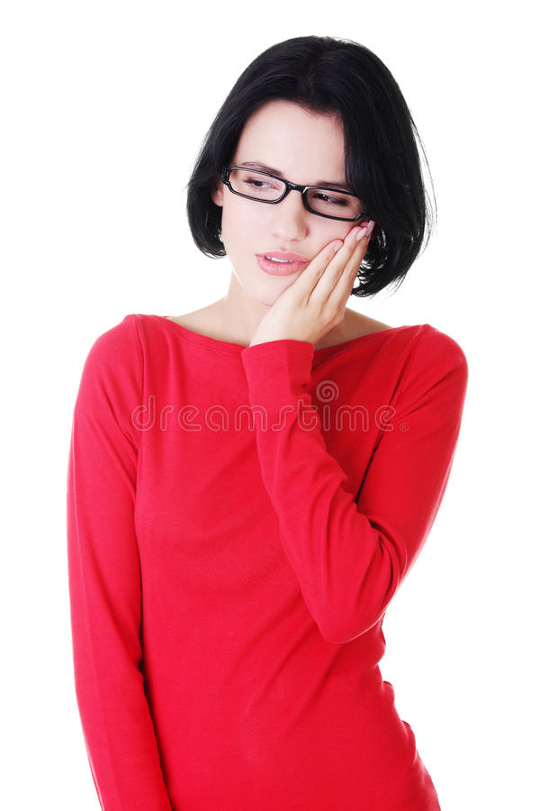 Young attractive woman in eyeglasses worried. royalty free stock photos