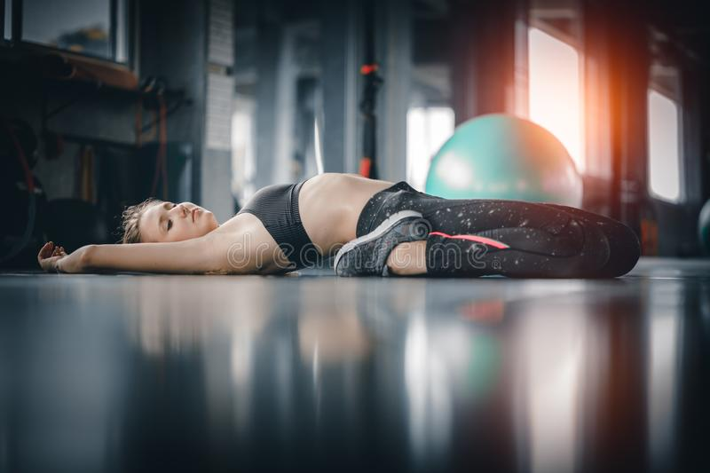 Young attractive woman fitness exercise workout in gym. Woman st stock image