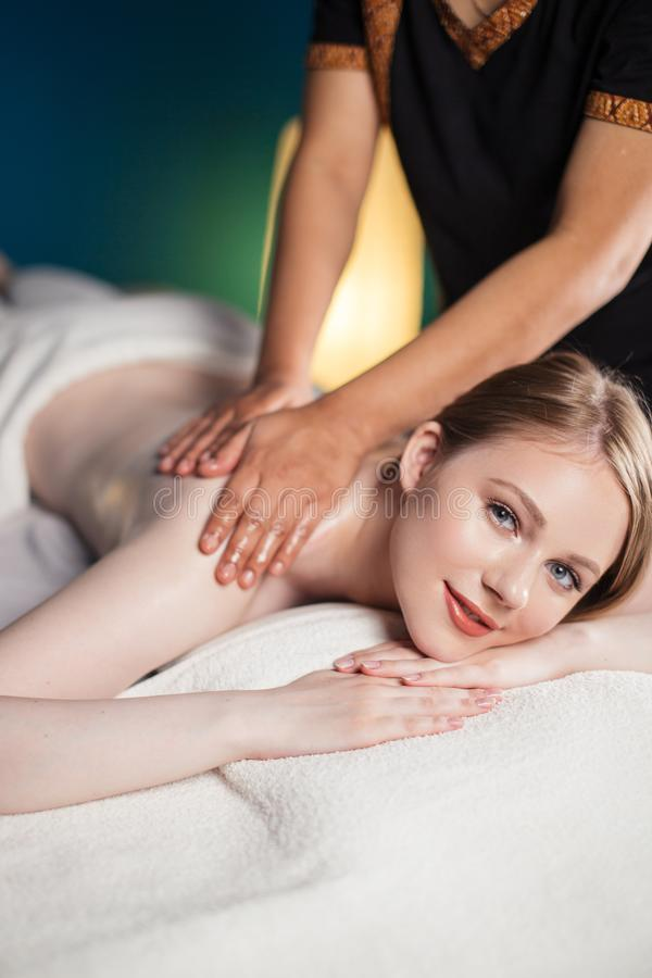 Young attractive woman getting massaging treatment at hospital royalty free stock photography