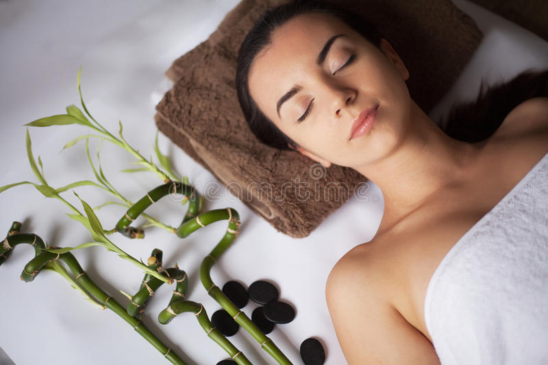 Young attractive woman getting spa treatment over white background stock photo
