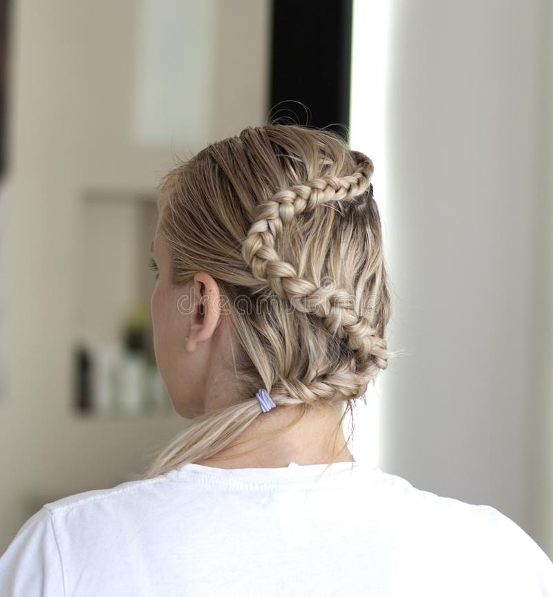 Young woman with braided hairstyle stock images