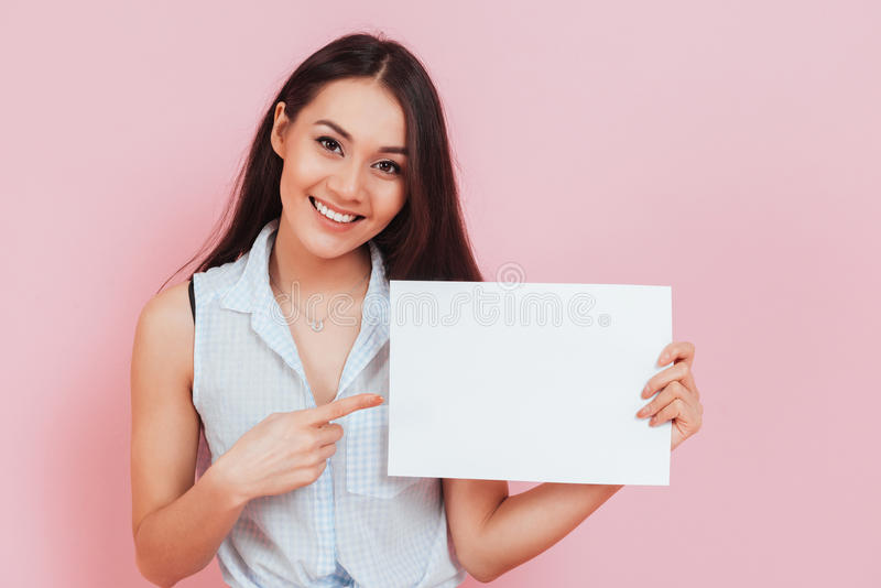 Young attractive woman holding blank billboard with copy space stock photos