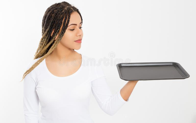 Young attractive woman holding empty pizza tray isolated on white background. Copy space and mock up. Blank template background. royalty free stock photo