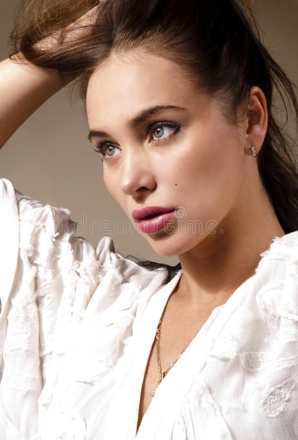 Young attractive woman holding her hair royalty free stock image