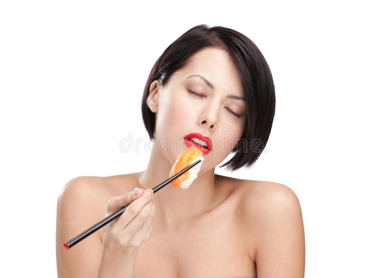 Download Young Attractive Woman Holding Sushi, Eyes Closed Stock Photo - Image: 24919298