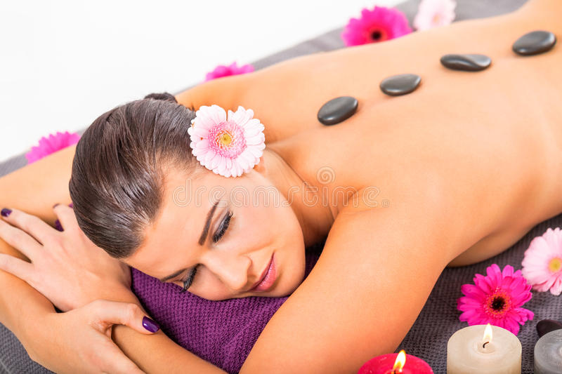 Young attractive woman hot stone massage wellness royalty free stock photos
